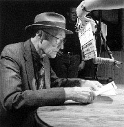 William Burroughs in the process of cut-up